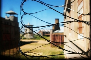 Barbed Wire with Prison in the background