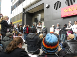 Action at Wells Fargo Nov.5th, protesting investment in detention centers.